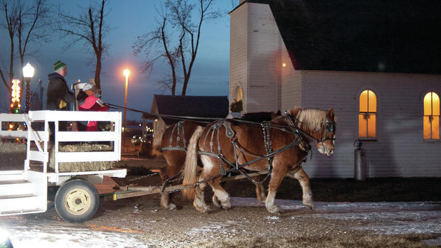 Glen Burnham's Belgian horse Flicka and Maggie give rides around the Pioneer Village for patrons Thursday night. Visit Santa in the Fire Hall and Tour the lights tomorrow night from 6-9 p.m.